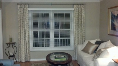 Pinch pleated drapes flanking windows to make them look bigger