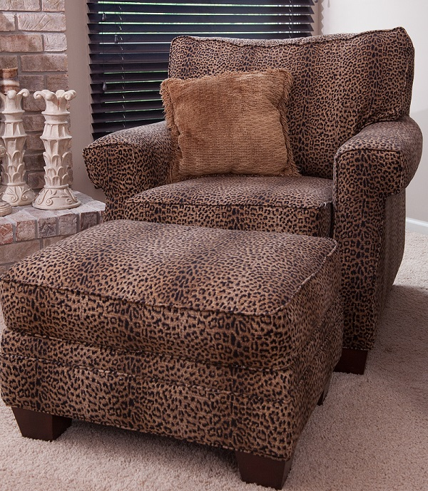 Upholstered Chair And Ottoman In A Cheetah Print.