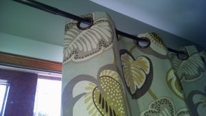 Up close view of window treatments with grommets