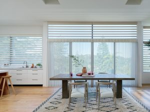 This room features vertical windows as well as horizontal, so using sheer shadings in both orientations unify the windows.  Motorization will, of course, make this etherial design functional as well as beautiful.